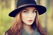 picture of overcoats  - Portrait of young beautiful woman in autumn coat - JPG