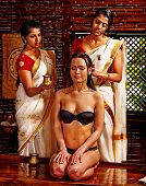 stock photo of ayurveda  - Young woman having head ayurveda spa treatment - JPG