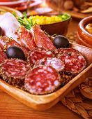 foto of smoked ham  - Tasty cold cuts on wooden table at home - JPG