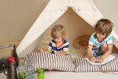 stock photo of teepee  - Child preschooler kids playing at home indoors with a teepee tent