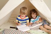 image of teepee  - Child playing at home indoors with a teepee tent - JPG