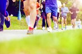 stock photo of competing  - Group of unidentified marathon racers running - JPG