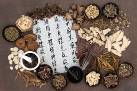 picture of chinese calligraphy  - Chinese herbal medicine with acupuncture needles and asian script - JPG