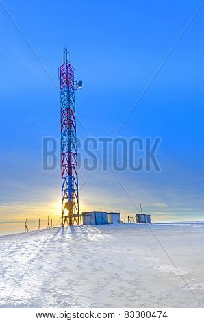 Telecommunications Tower at sunset in winter