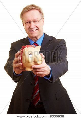 Businessman Offerering Piggy Bank