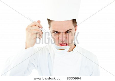 Caucasian Cook Tasting A Soup Doing A Grimace