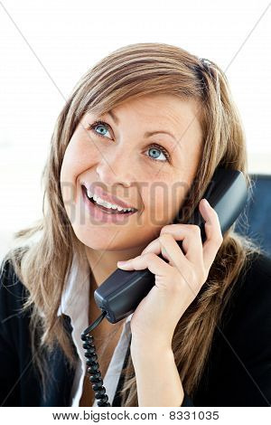Radiant Businesswoman Talking On Phone In Her Office