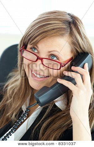 Bright Young Businesswoman Talking On Phone Wearing Glasses