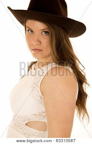 Side View Of A Cowgirl Wearing A White Dress And Cowboy Hat