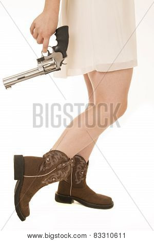 Cowgirl Dress From Waist Down Holding A Large Revolver