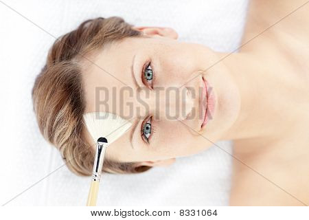 Bright Young Woman Receiving A Beauty Treatment