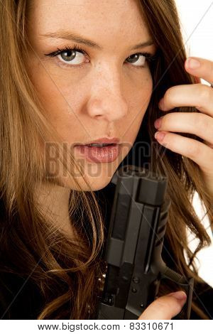 Female Model Holding Pistol Close Up Serious Expression