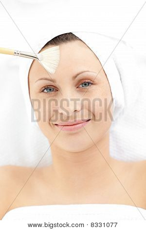 Merry Young Woman Receiving A Beauty Treatment