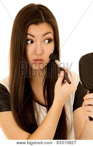 Cute Asian American Teen Applying Blush Looking In Mirror