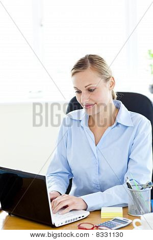 Concentrated Caucasian Businesswoman Using Her Laptop