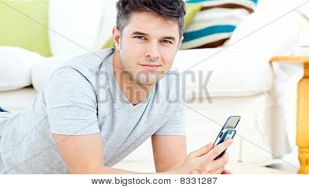Handsome Man Smiling At The Camera Sending A Text