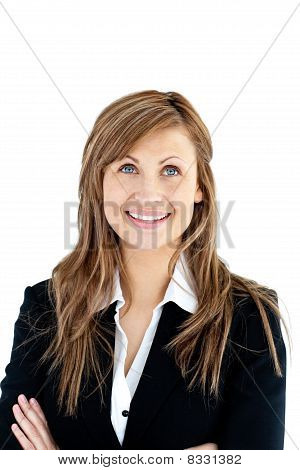 Cheerful Businesswoman With Folded Arms Looking Upwards