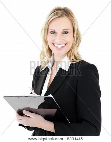 Glowing Young Businesswoman Taking Notes On Her Clipboars