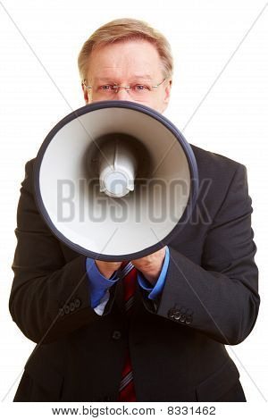 Businessman Giving Orders With Megaphone