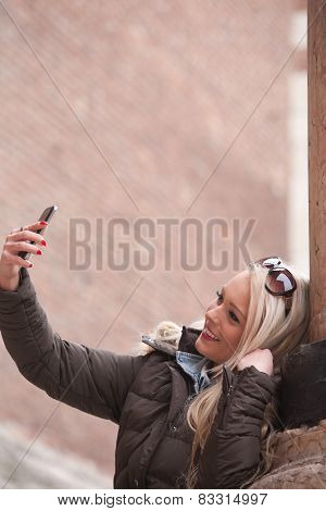 Blonde Tourist Making A Selfie Outdoors