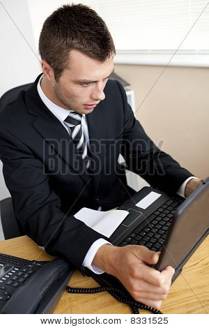 Shocked Businessman Looking At This Laptop