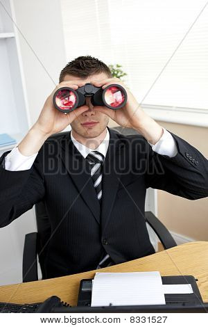 Caucasian Young Businessman Looking Through Binoculars