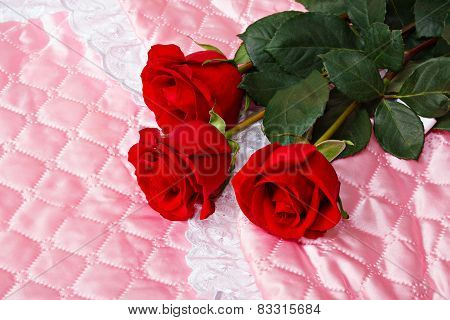 Red Roses On Pink Satin.