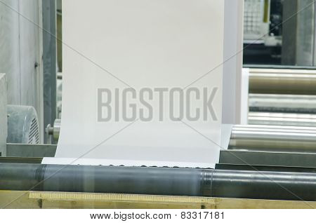 Printing machine running a long off paper over its rollers