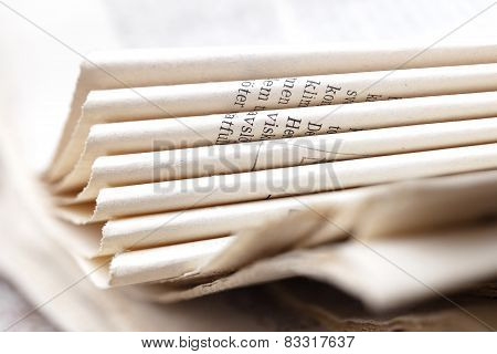 Bent Pages Of Newspaper