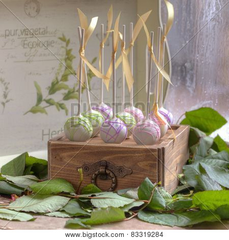 cake-pops on a wooden box
