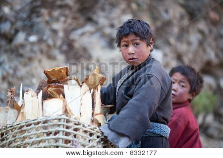 Two Tibetan Boys With Basket