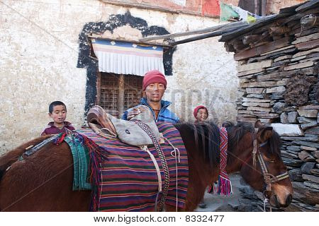 Three Young Buddhist Monks With Horse