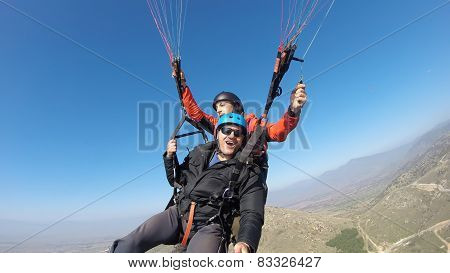 Two paragliders showing adrenaline buzz