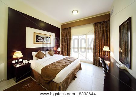 Bedroom With White Walls, Opened Curtain Big Double Bed General View