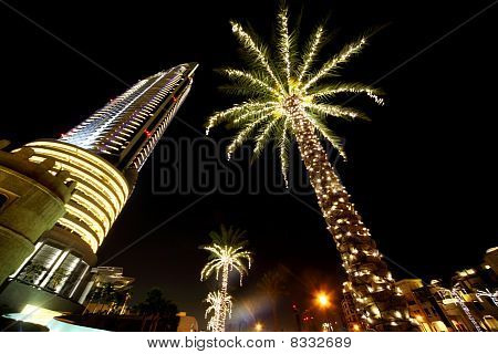 Night Dubai Palms With Decor Lamps And Skyscraper, United Arab Emirates