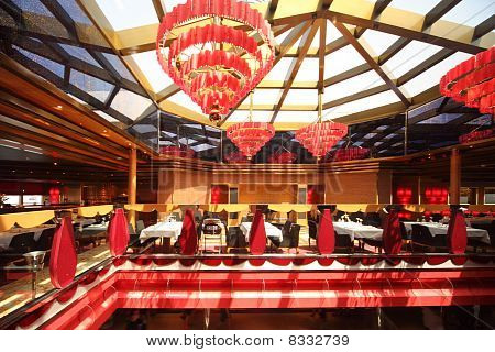 Bright Red Colored Dinning Room On Balcony Second Floor General View