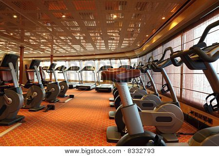 Large Gym Hall With Treadmills And Exercise Bicycle In Cruise Ship