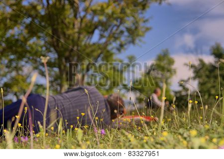 Old man resting on a meadow