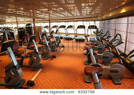 Large Gym Hall With Treadmills And Exercise Bicycle In Cruise Ship General View