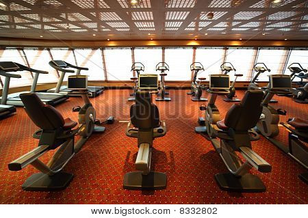 Large Gym Hall With Exercise Bicycle In Cruise Ship View From Back