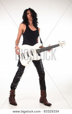 Rock n roll long hair guy playing guitar