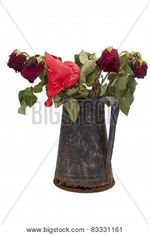 Dried Rose Bouquet In A Rusty Jug With Deflated Balloon On White