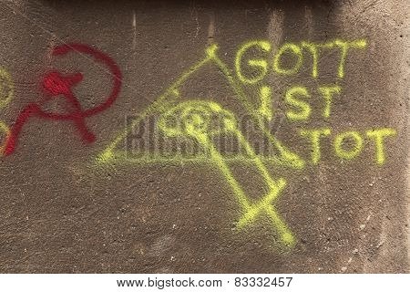 Gott Ist Tot (The God is Dead). Eye of Providence. Stick and Hummer. Street graffiti in Gdansk, Poland.
