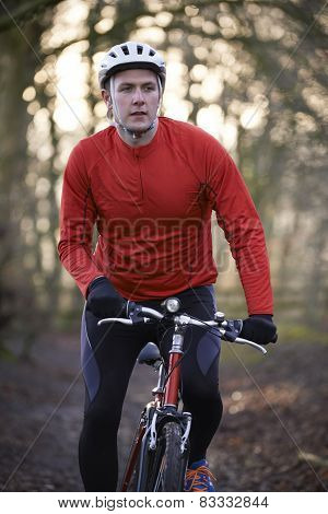 Man Riding Mountain Bike Through Woodlands