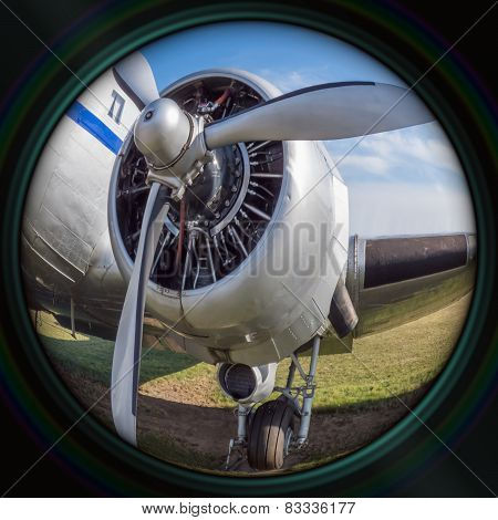 Old Airplane Engine In Objective Lens