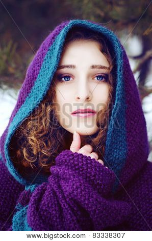 Mysterious Young Woman In Purple Cape With A Hood