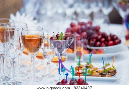 Banquet Table With Fruits, Juice And Snacks Close Up
