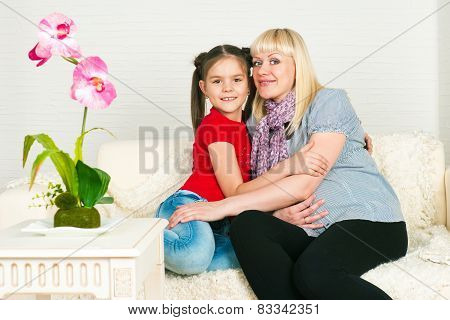 A Pregnant Woman And Her Eldest Daughter