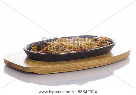 Soba Noodles With Veal And Vegetables Over White Background