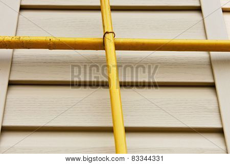 Two Gas Pipes Over The Siding Wall